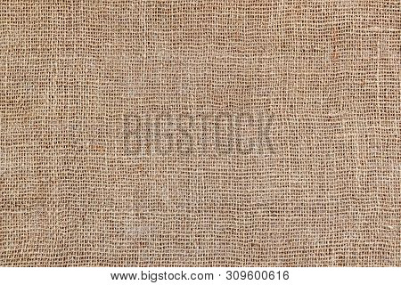 Rural Texture Of Sackcloth. Background Of Very Coarse, Rough Fabric Woven Made Of Flax, Jute Or Hemp