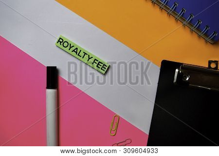 Royalty Fee text on sticky notes with color office desk concept poster