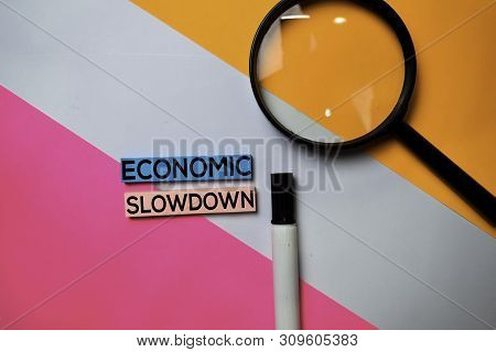 Economic Slowdown Text On Sticky Notes With Color Office Desk Concept
