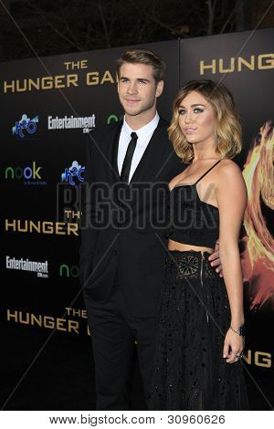 LOS ANGELES, CA - MARCH 12: Liam Hemsworth, Miley Cyrus at the premiere of Lionsgate's 'The Hunger Games' at Nokia Theater L.A. Live on March 12, 2012 in Los Angeles, California