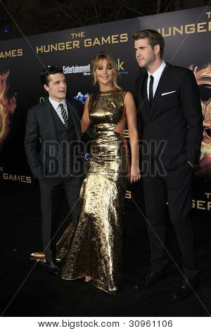 LOS ANGELES, CA - MARCH 12: Josh Hutcherson, Jennifer Lawrence, Liam Hemsworth at the premiere of Lionsgate's 'The Hunger Games' at Nokia Theater L.A. Live on March 12, 2012 in Los Angeles, California