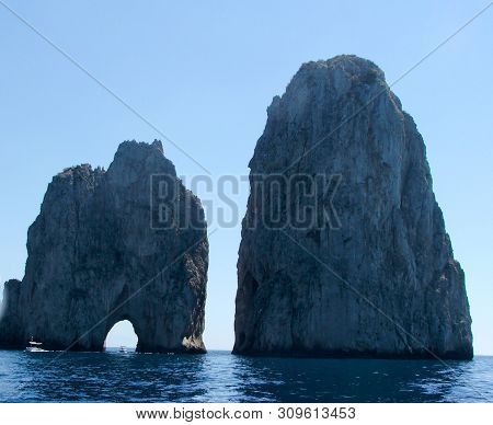 Summer Holidays In Capri, Naples. With Its Stacks And Its Sea