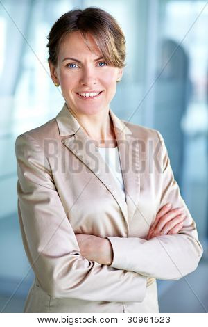 Image of successful businesswoman looking at camera