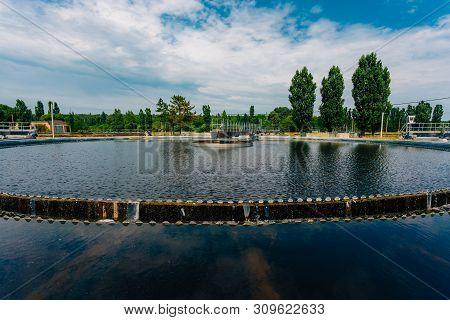 Modern Urban Sewage Treatment Plant. Water Flowing In Sedimentation Tank