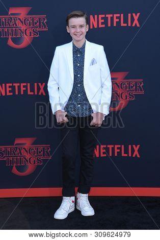 LOS ANGELES - JUN 28:  Maxwell Jenkins arrives for the Netflix 'Stranger Things' Season 3 Premiere on June 28, 2019 in Santa Monica, CA