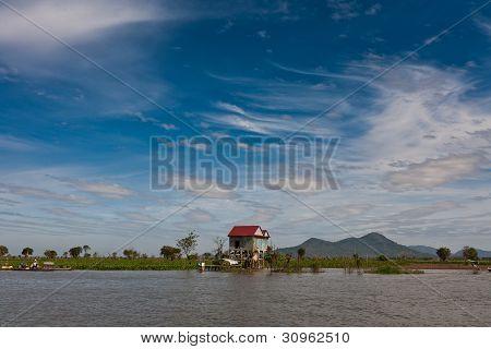 Stilt House And Landscape At Tonle Sap Lake Cambodia