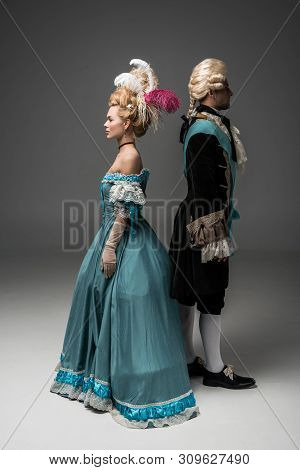aristocratic woman and man in Victorian clothes standing back to back poster