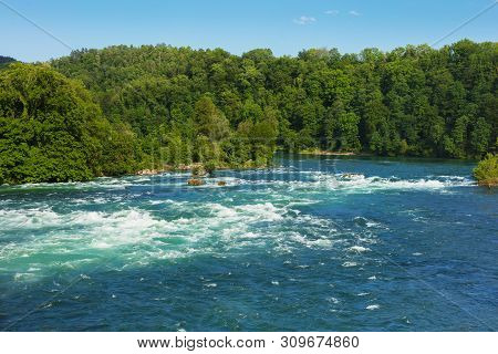 The Rhine River Just Above The Rhine Falls Waterfall In Switzerland At The Beginning Of June.
