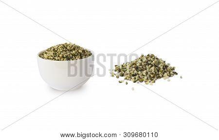 Hemp Seeds Isolated On White. Bowl With Hemp Seeds Isolated On White Background. Peeled Raw Hemp See