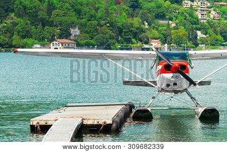 Red Floatplane Or Seaplane Moored On Como Lake.