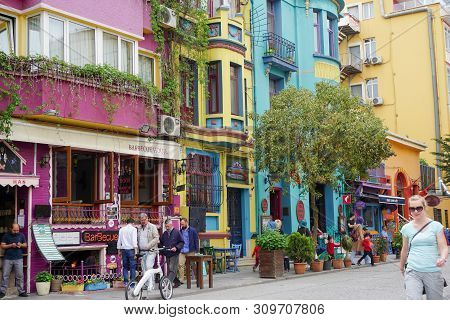 Tourists And Locals In The Colorful Golden Horn Neighborhood In Istanbul With Shops And Restaurants
