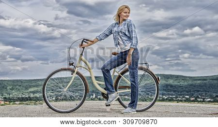 Woman Rides Bicycle Sky Background. Benefits Of Cycling Every Day. Keep Fit Shape Easy With Regular