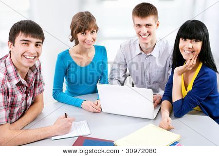 Young students studying together with laptop