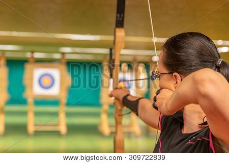 Archery As A Sport Discipline Run In The Hall And In The Nature. Competition For The Best Shot An Ar