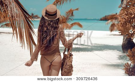 Beautiful Luxury Slim Back Of Brunette Woman In Beige Swimsuit Posing By Ocean Water. Sexy Tanned Bo