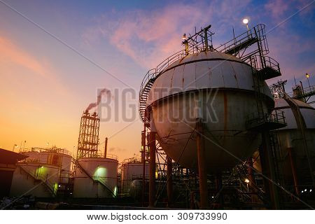 Gas Storage Sphere Tanks In Petrochemical Industrial On Sunset Sky Background, Oil And Gas Refinery