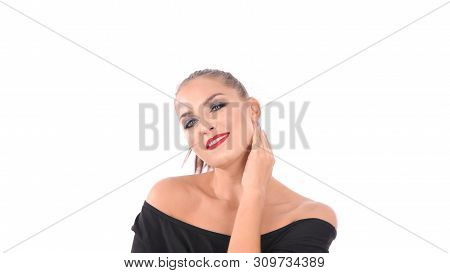 Beauty concept. A charming woman is fondling her face on a white background. poster