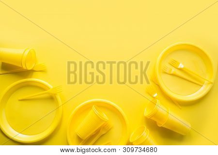 Singe use picnic utensils for recycling on yellow. Environment eco friendly discarded plastic garbage collection for recycle concept.Top view. Flat lay. poster