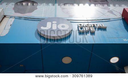 Bengaluru, India June 27,2019 : Reliance Jio Bill Board On Top Of The Shop