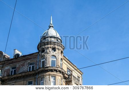Old Retro Neglected Beautiful City House Building On Clear Blue Sky Background