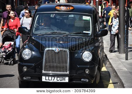 London: May 13, 2019 - London Taxi At Oxford Street W1 Westminster In Uk England