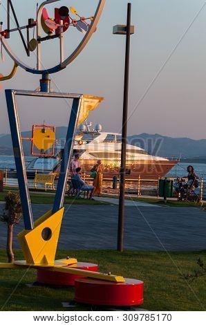 Golfo Aranci Sardinia, June 29,2019 : Beautiful Orange Sunset In The Sea Harbor With Moored Yachts
