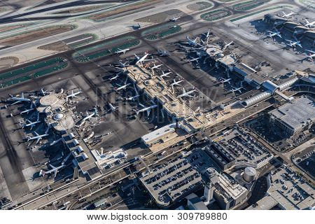 Los Angeles, California, USA - August 16, 2016:  Aerial view of jet airplanes surrounding Los Angeles International Airport terminals in Southern California.
