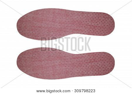 Orthotic Insoles Made Of Flavored Latex On A White Background.