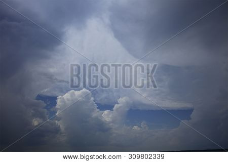 Beautiful White Fluffy Clouds In The Bright Blue Sky