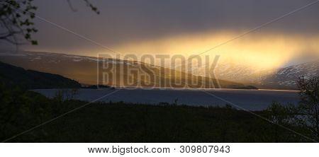 Fantastic Cloud Formations Over Lake Tornetrask In Sweden