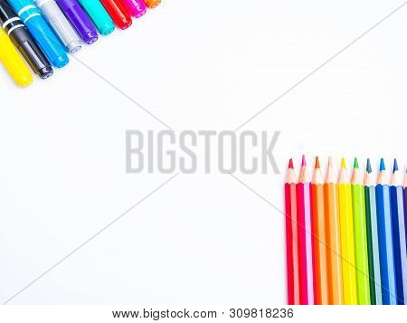 Back To School Background With Accessories For The Schoolroom - Pencils, Markers Isolated On White W