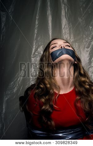 A Beautiful Girl With A Gag In Her Mouth As A Symbol Of Censorship. Silence Of Issues Of Sexual Disc
