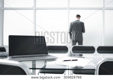 rear view of a stylish businessman looking out the window