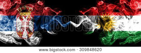Serbia Vs Kurdistan, Kurdish Smoky Mystic Flags Placed Side By Side. Thick Colored Silky Smokes Comb