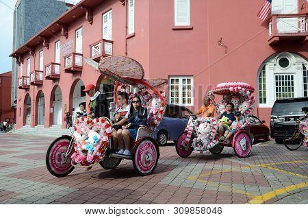 Melaka, Malaysia - 25 Jun, 2019: The Decorated Trishaw Carry Tourists To Tour Around In Dutch Square