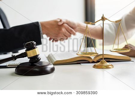 Handshake After Cooperation Between Attorneys Lawyer And Clients Discussing A Contract Agreement Hop