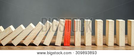 Wooden Blocks And The Effect Of Dominoes. Risk Management Concept. Successful Strong Business And Pr