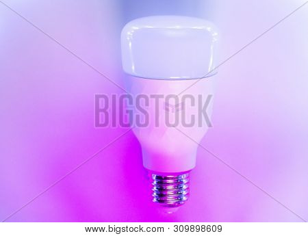 Saint-petersburg, July 04, 2019. Smart Home Xiaomi Rgb Bulb Lamp In Trendy Backlight. Yeelight Led S
