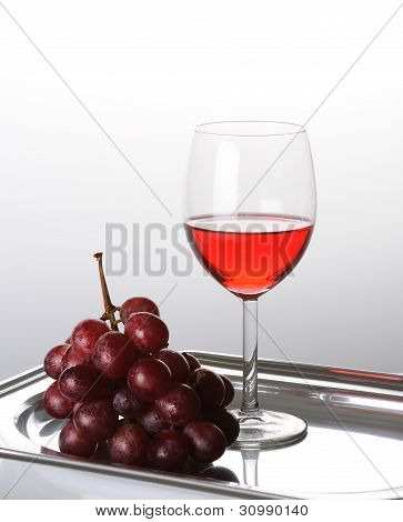 Glass Of A Red  Wine With Grape