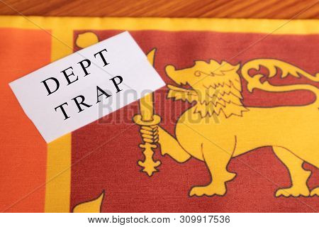 Concept Of Dept Trap Printed On Paper, Sri Lankan Flag As A Background