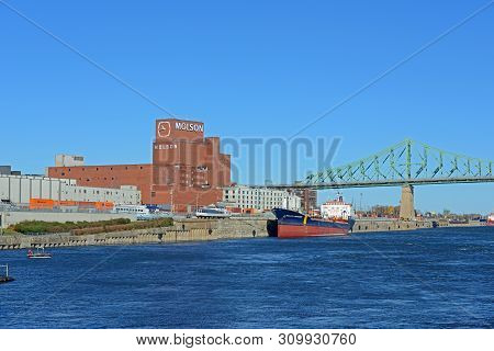 Montreal, Canada - Nov 2, 2012: Molson`s First Brewery And Jacques Cartier Bridge At St. Lawrence Ri