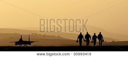 Silhouette of military attack aircraft on vibrant sunset sky poster