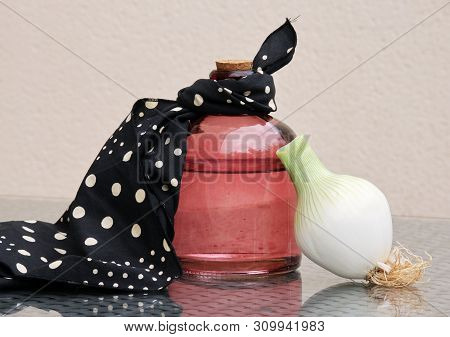 Vintage Glass Bottle, Polka Dot Napkin And White Onion Bulb Against A High Key Background. Retro Cou