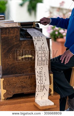 Classic Hand Crank Music Box Plays Songs And Tunes Fed By Slotted Paper.