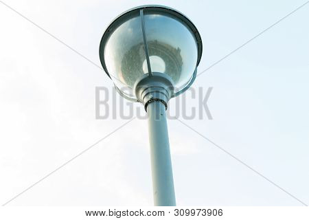Vintage Springy Streetlight Lamp And Skybackground Park Lamp