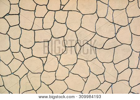 The Plastered Wall With An Abstract Mesh Mosaic Pattern Of Monotonous Cream Color For The Textured B