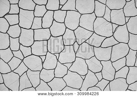 The Plastered Wall With An Abstract Mesh Mosaic Pattern Of Monotonous Gray Color For The Textured Ba