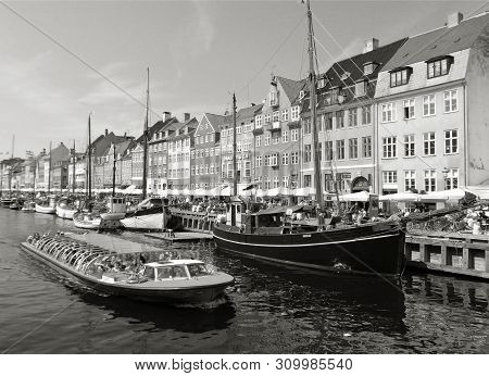 Monotone Image Of Cruise Ship With So Many People On The Canal Of Nyhavn In Copenhagen, Denmark, Eur