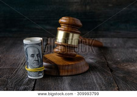 Concept Of Corruption In  Judiciary, Us Dollars And The Judges Gavel.on Wooden Background