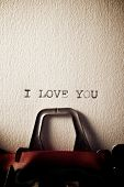 The sentence, Y Love You, written with a typewriter. poster